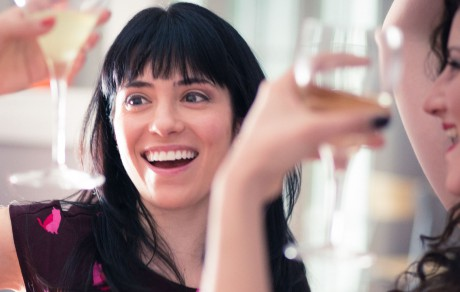 Woman laughing with her martini